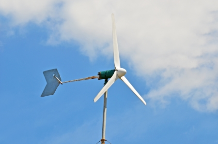 Wind power turbine on blue sky background  photo