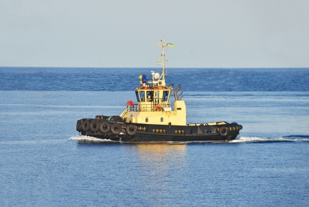 Tugboat in harbor quayside on Odessa, Ukraine photo