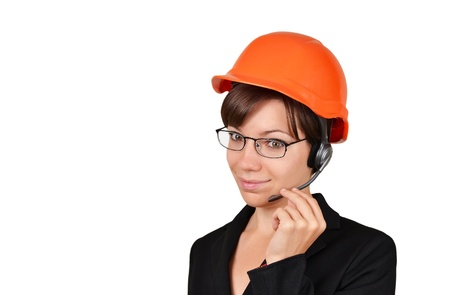 Smiling young woman architect talking on headset Stock Photo