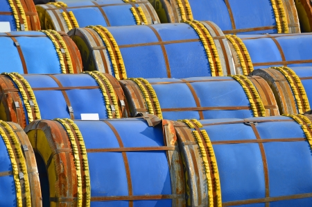 Stacked steel metal-roll ready for shipment in port Stock Photo - 16272609
