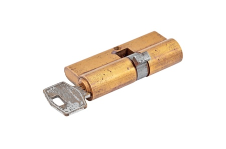bidirectional: Door lock cylinder core with key, isolated on white background Stock Photo
