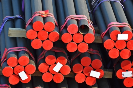 Stacked PVC and steel pipe ready for shipment photo