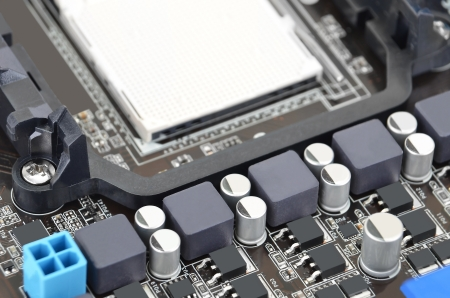 microelectronics: Printed computer motherboard board with microcircuit, close-up Stock Photo