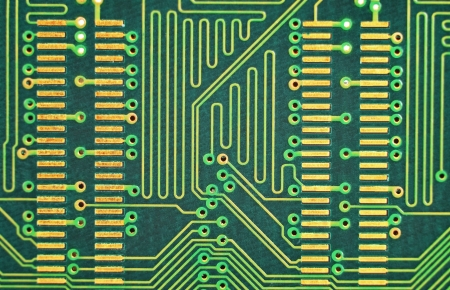 Close up of a printed green computer circuit board photo