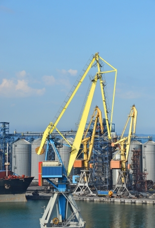 Cargo crane, ship and grain dryer in port Odessa, Ukraine Stock Photo - 17678654