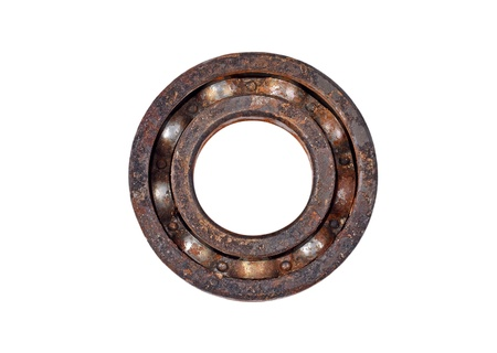 hinge joint: Old and rusty ball bearing, isolated on white background