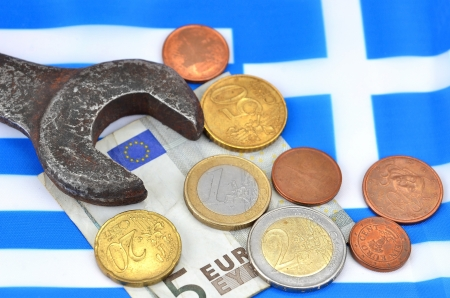 Earning in Greece concept with Euro money, flag and wrench Stock Photo