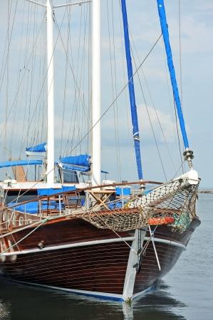 Vintage wooden yacht over harbor pier, Odessa, Ukraine photo