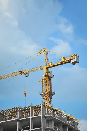 Crane and building construction site against blue sky Stock Photo - 20888641