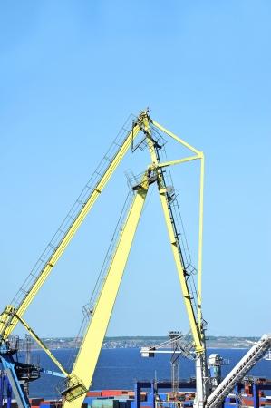 Port cargo crane over blue sky background photo