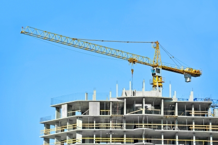 Crane and building construction site against blue sky Stock Photo - 20889274