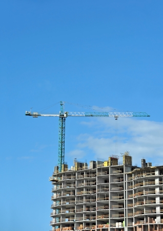 Crane and building construction site against blue sky Stock Photo - 21119697