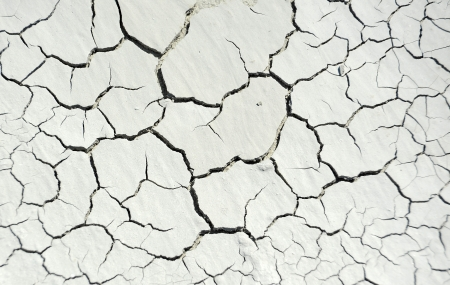 cleft: Gray cracked concrete texture background, close up
