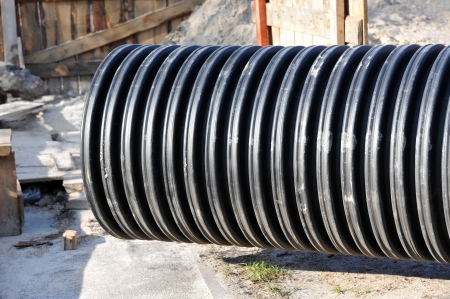 Great black PVC pipe on construction site photo