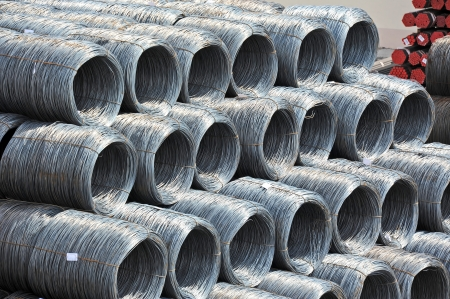 Stacked steel wire roll and pipe, ready for shipment in port photo