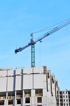 Crane and building construction site against blue sky Stock Photo - 23259274