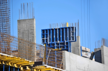 social apartment: Building construction site work against blue sky Stock Photo
