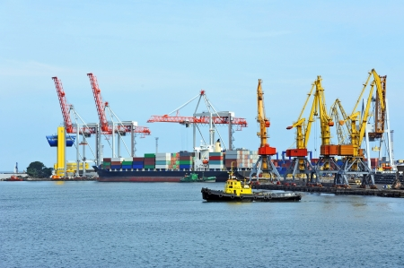 Container stack and ship under crane bridge Stock Photo