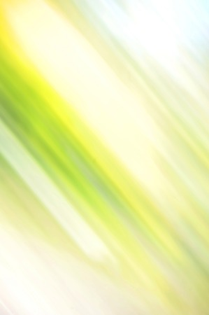 blured: Abstract blured green background with yellow spot