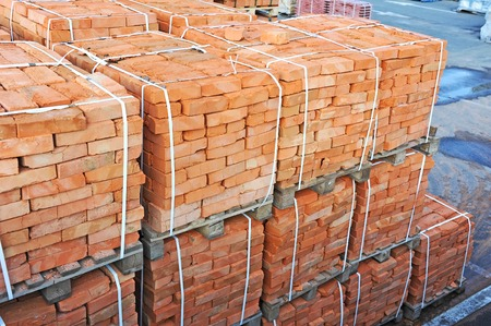 brick earth: Stack of orange clay brick on construction site