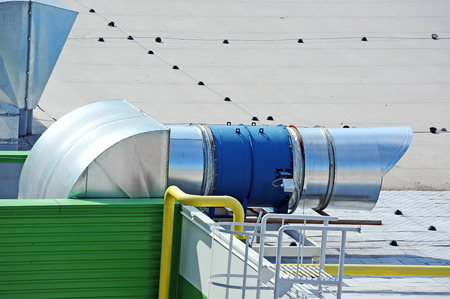 Industrial air conditioning and ventilation systems on a roof photo