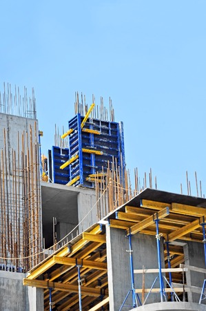 Building construction site work against blue sky photo