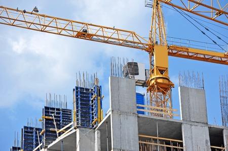 building loan: Crane and building construction site against blue sky