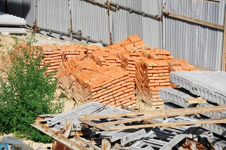 red clay: Stack of red clay brick on construction site