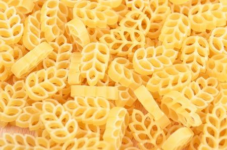 maccheroni: Close up of wheat shaped pasta as background