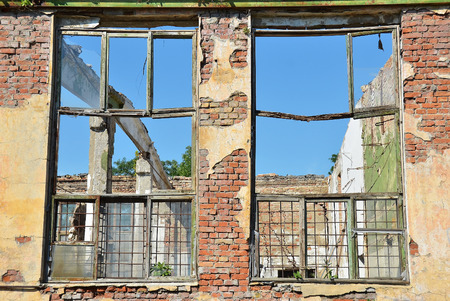 without window: Broken window of old abandoned building without roof Stock Photo