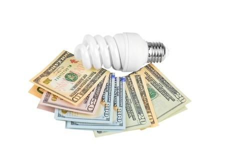 outgoings: Energy saving light bulb and money on white