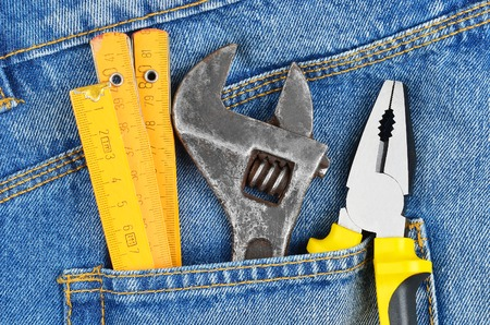 Job concept - tool in blue jeans pocket photo