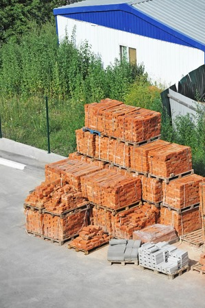 brick earth: Stack of red clay brick on construction site