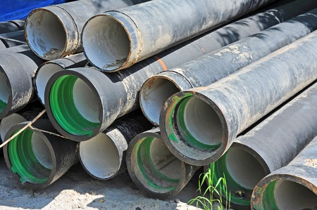 sump: Ceramic and PVC sewer pipe on construction site Stock Photo
