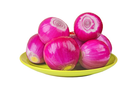 poignant: Peeled red onion on plate, isolated on white background