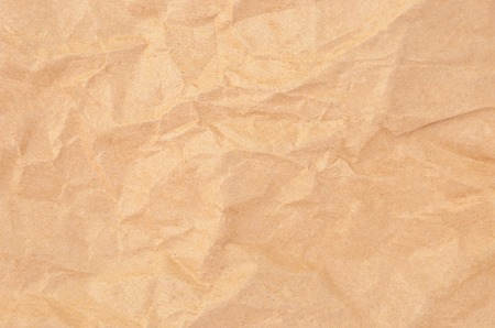 oiled: Wrinkled packaging paper background, close up, DOF