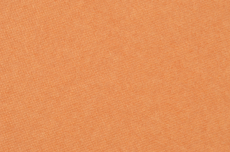 structured: Embossed cardboard background, brown color, close up