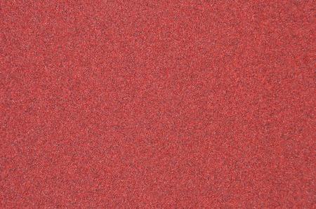 sandpaper: Red rough textured sandpaper background, close up Stock Photo