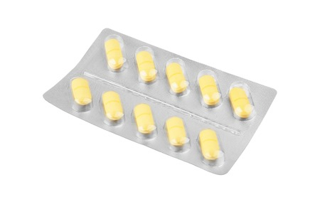 blister package: Pills in aluminium blister package, isolated on white background