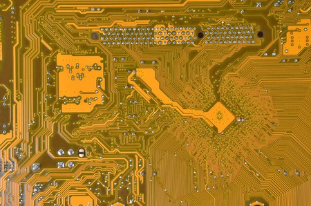 cmos: Close up of a printed orange computer circuit board