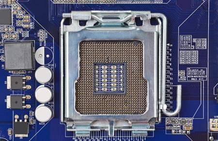megabyte: Printed computer motherboard, CPU socket, close up, DOF