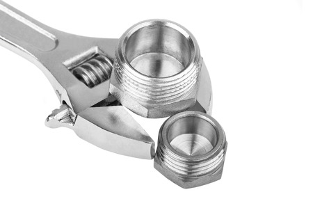 plumbing accessories: Plumbing fitting and wrench, isolated on white background