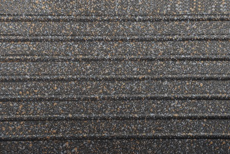 hard alloy: Black spotted textured  metallic background, close up