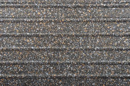 metallic: Black spotted textured  metallic background, close up