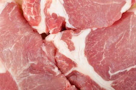 flesh eating animal: Raw pork meat sliced on steak portion