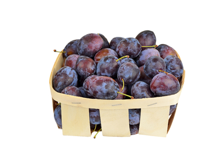 wattled: Plum in a wattled basket, isolated on a white background