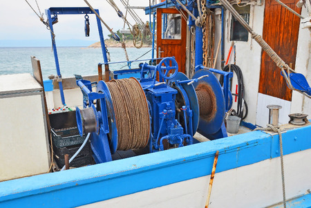 winch: Anchor winch mechanism with hawser on ship deck Stock Photo