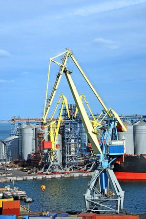 odessa: Cargo crane, ship and grain dryer in port Odessa, Ukraine