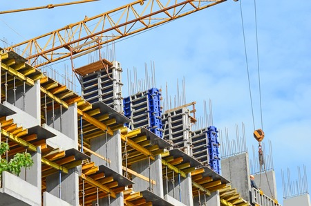 formwork: Concrete formwork and crane on construction site