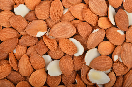 apricot kernels: Dried apricot kernel, close up as background Stock Photo